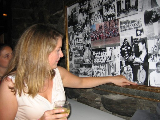Amy Drabek pointing to a picture of her husband, Greg Siddons